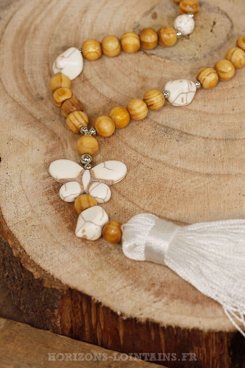 Collier sautoir perles bois papillons pompon écrus effet marbre craquelé