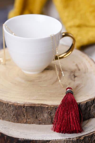 collier acier doré pompon rouge sautoir classe bijoux femme