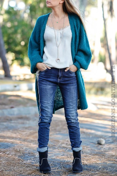 Jean femme bleu denim avec bande perlée brillante