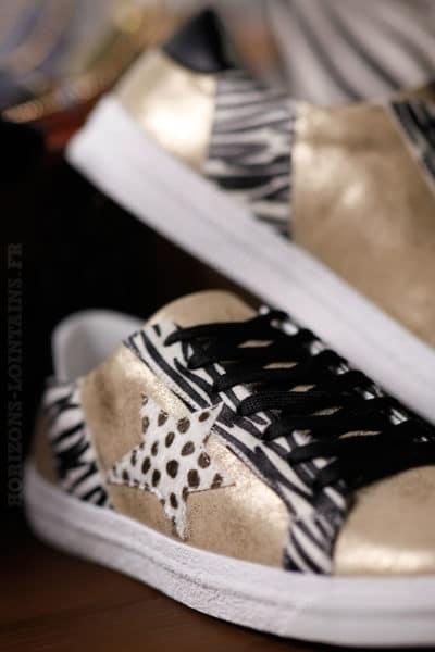 baskets femme dorées zébrées, étoile léopard style golden goose